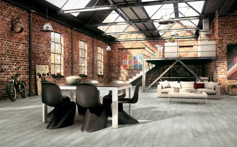 Salotto industrial, open space e pareti con mattoni a vista, tavolo da pranzo con sedie