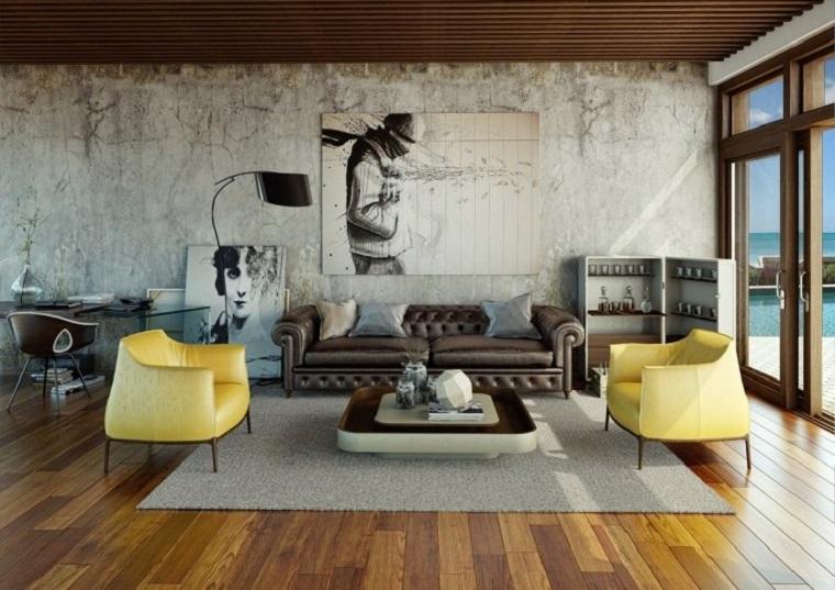Casa stile industriale moderno, parete rustica in cemento, soggiorno con divano in pelle