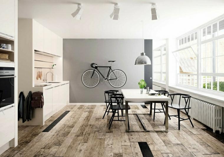 arredare cucina soggiorno piccola parete dipinta di grigio con bici appesa