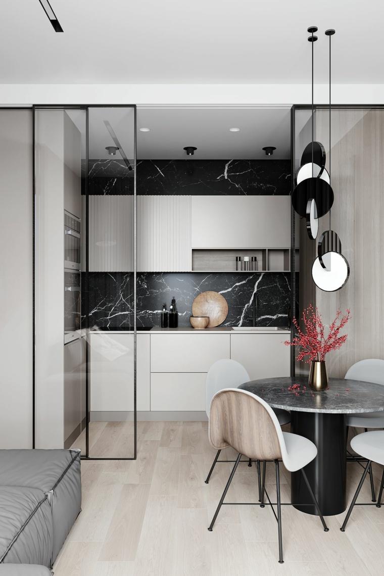 arredare cucina soggiorno piccola parete divisoria con porte di vetro scorrevoli tavolo da pranzo rotondo