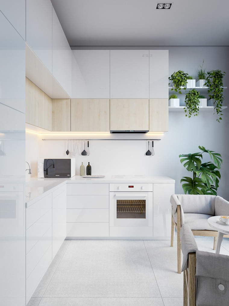 arredare open space piccolo cucina ad angolo bianca tavolo da pranzo con due sedie