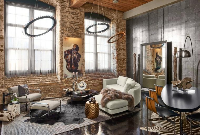Soggiorno con parete in mattoni a vista, arredamento stile industriale