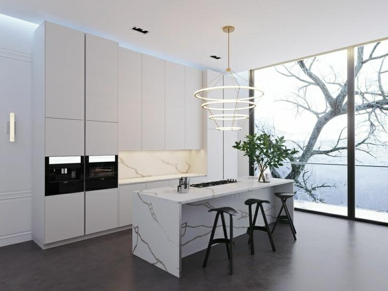 isola centrale con rivestimento in marmo pavimento in legno parquet cucina bianca