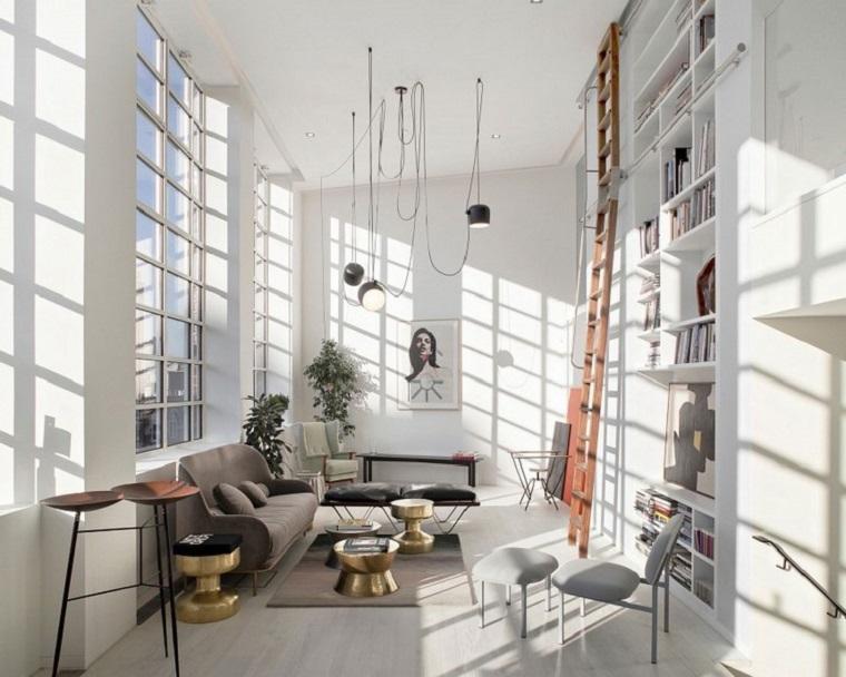 Arredamento stile industriale, stanza con divano e parete con libreria