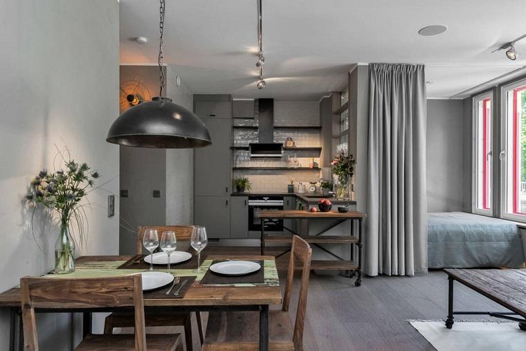 Arredamento stile industriale, monolocale con cucina e camera da letto insisme