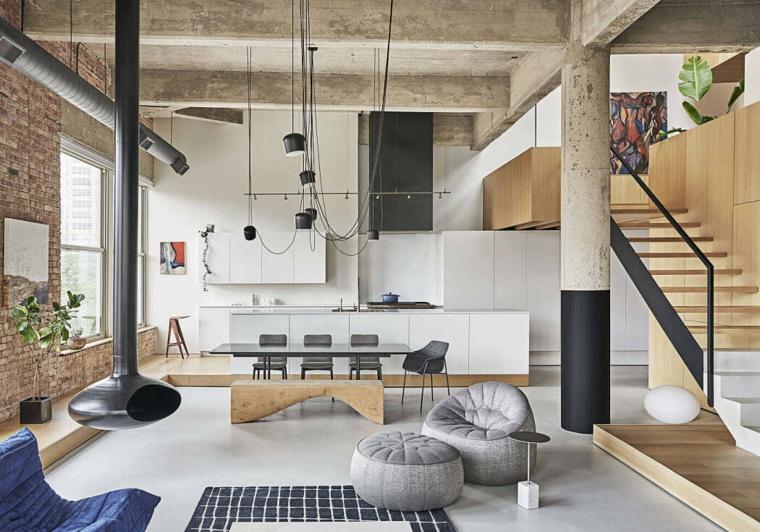 Arredamento industriale, open space con scale interne, cucina con tavolo da pranzo