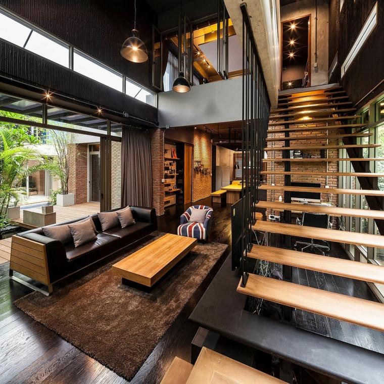 Loft con soppalco e scale interne in legno, open space soggiorno e cucina, arredamento stile industriale