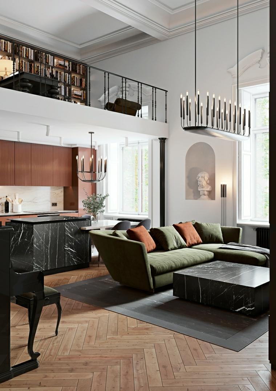 soggiorno con angolo cottura divano verde con cuscini open space con soppalco