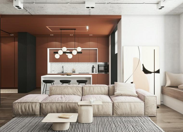 soggiorno con divano beige cucina ad angolo con penisola salotto con tappeto grigio