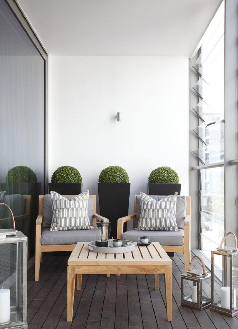 Arredo terrazzi 30 soluzioni anche per uno spazio dalle for Mobili da terrazzo in legno