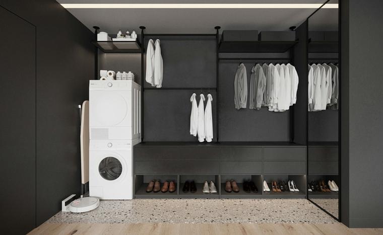 Stanza armadio con zona lavanderia, cassetti per le scarpe, camicie bianche appese