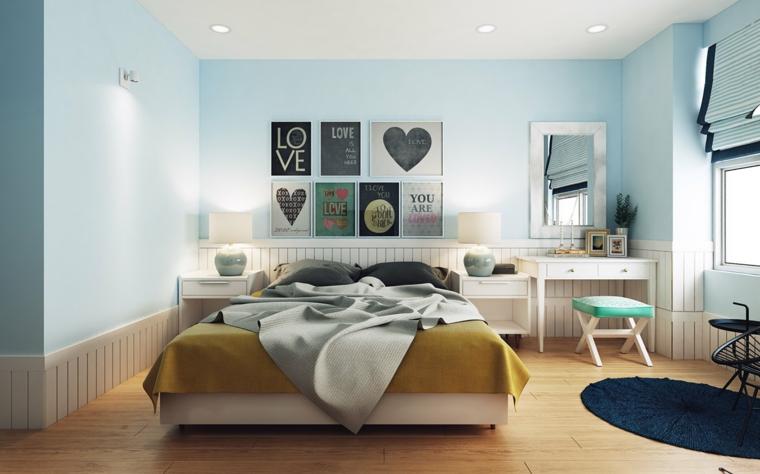 Idee arredamento camera da letto, parete dipinte di colore azzurro, decorazione con quadri
