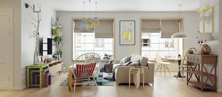 Soggiorno con divano di colore beige, mobili in legno dipinti, soggiorno con finestre luminose