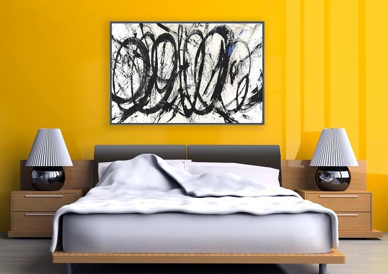 colori-pareti-giallo-luminoso-camera-letto