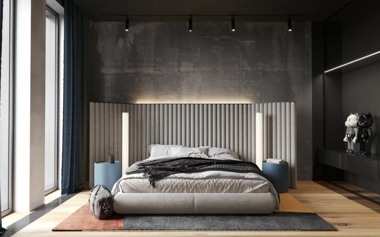 Testata letto in tessuto imbottito, parete grigia, faretti sul soffitto, come decorare parete dietro letto