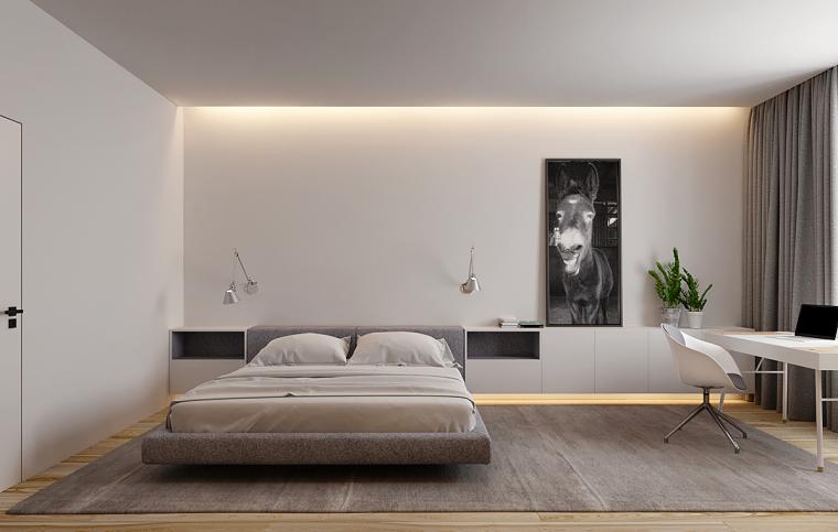 Pavimento in legno parquet, tappeto colore grigio, parete bianca, decorazione con quadro disegno asino