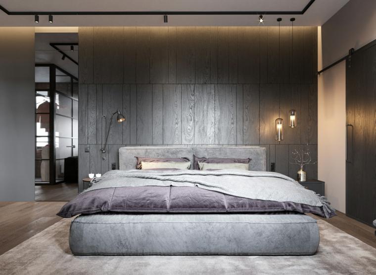 Parete dietro letto matrimoniale, parete in legno, lampade in sospensione, faretti sul soffitto