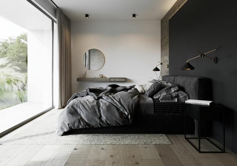 Parete dipinta di nero, parete dietro letto matrimoniale, specchio rotondo, pavimento in legno parquet