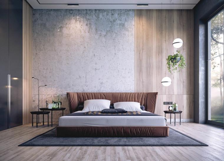 Testa letto imbottita, colori rilassanti, parete con legno, lampade sospese, pianta con foglie verdi
