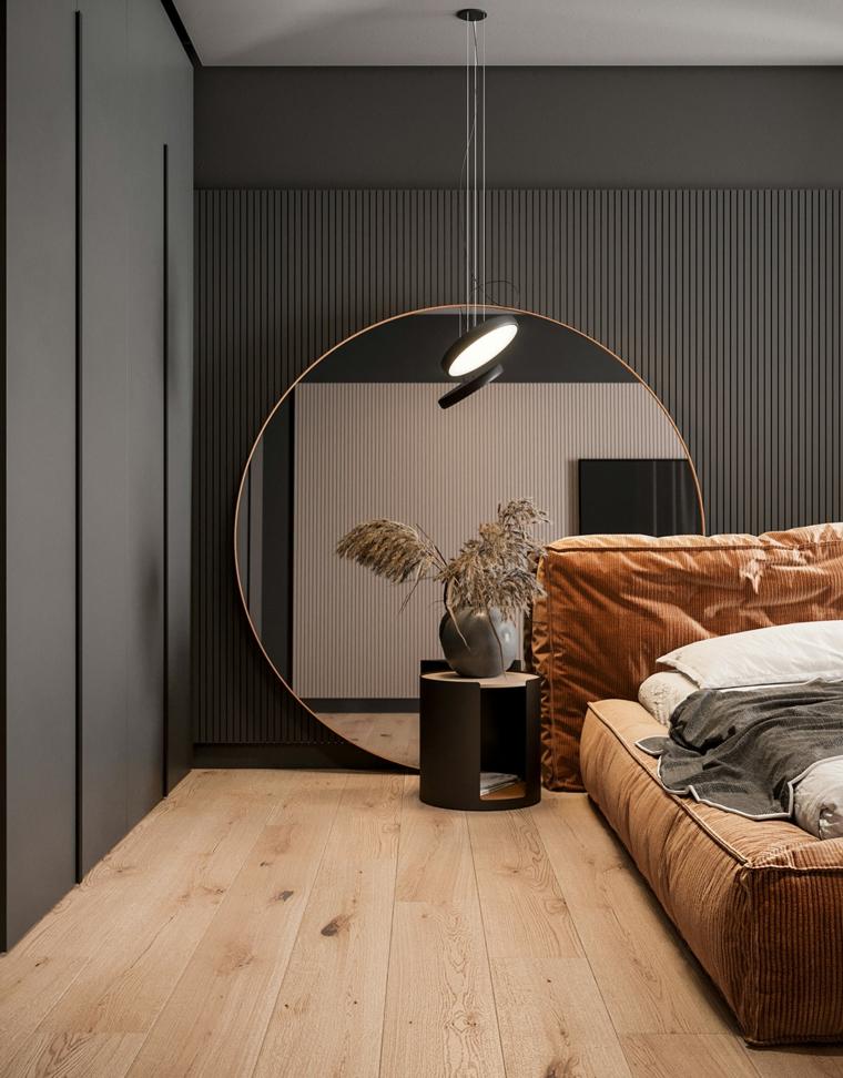 Arredamento moderno casa, zona notte con grande specchio rotondo