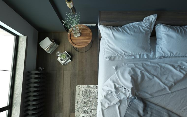 Colori rilassanti per camere da letto, parete dipinta di colore nero, comodino di legno con pianta