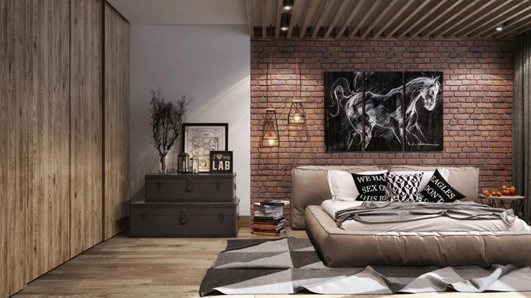 Colori rilassanti per camere da letto, parete effetto pietra, mobili con valigie vintage
