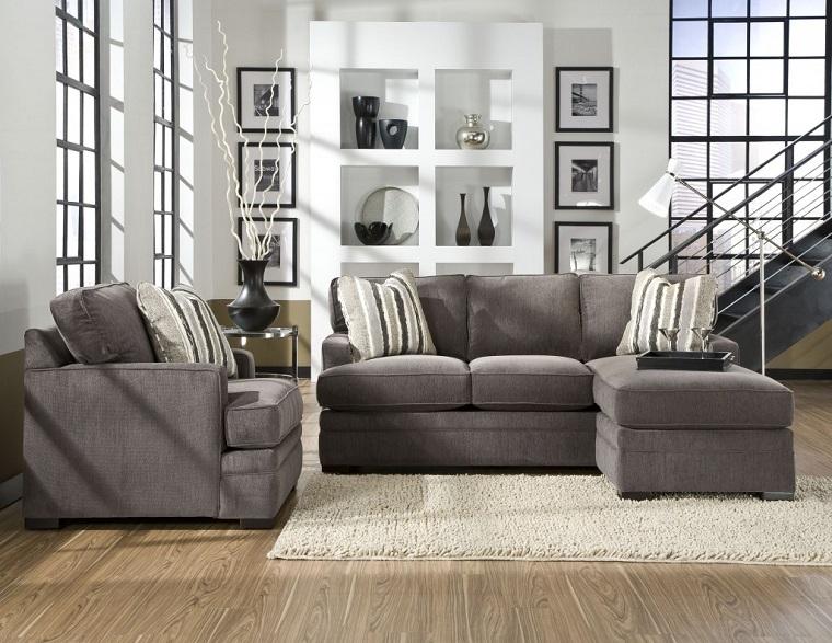 mobili per soggiorno-divano-grigio-pareti-bianche