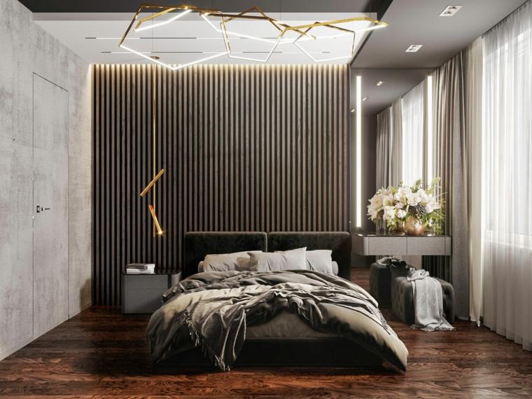 Colori camera da letto, parete con illuminazione nascosta, lampadario forma geometrica di metallo