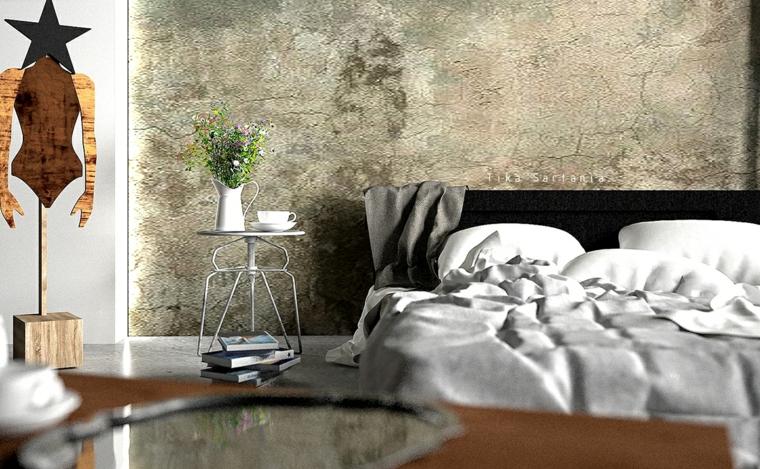 Tinte pareti, parete effetto pietra, comodino in metallo, decorazioni in legno, biancheria colore grigio