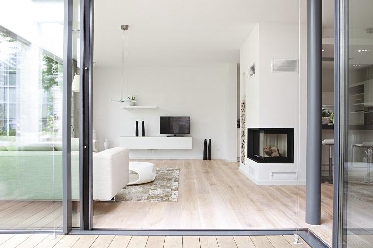 Salotto Moderno Con Camino E Veranda Interior Design : Salotto con camino una zona living che unisce comfort e