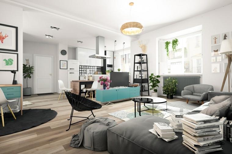 Open space soggiorno cucina, zona living con pareti dipinte di colore bianco