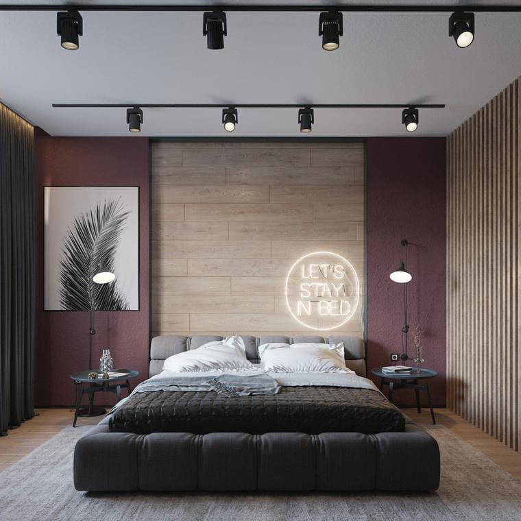 Arredamento moderno casa, zona notte con parete in legno, letto con testata morbida