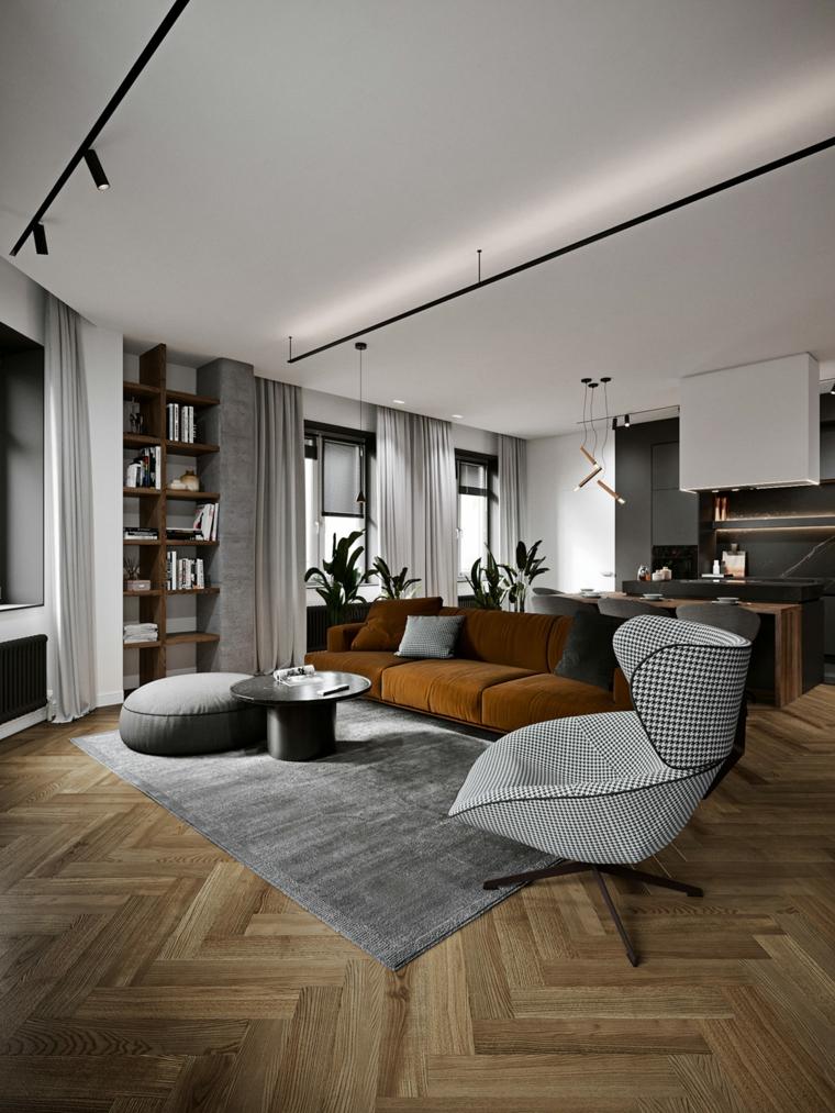 Zona living con poltrona e pouf, salotti moderni, open space cucina e soggiorno