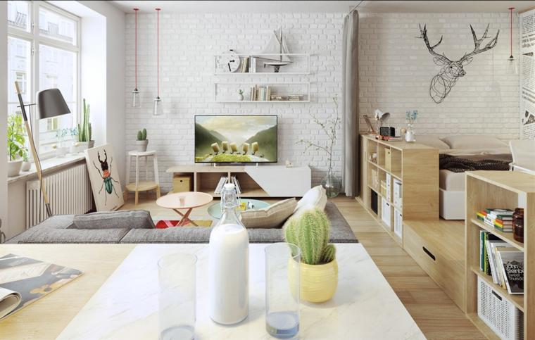 Salotto con divano grigio, soggiorno con parete in mattoni a vista