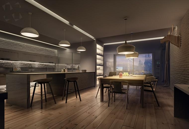 Open space cucina sala da pranzo, pavimento in legno parquet, illuminazione con lampade sospese