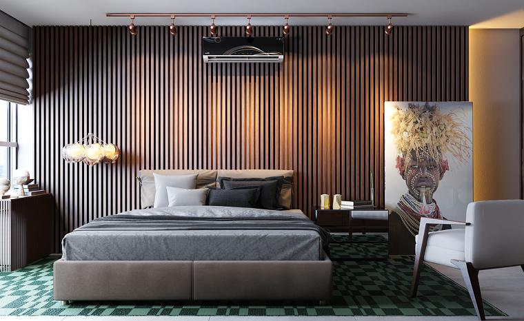 Parete dietro letto matrimoniale, parete in legno, faretti sul soffitto, pavimento con tappeto