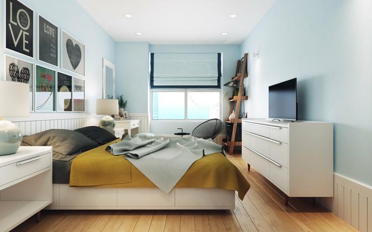 Idee arredamento camera da letto, pareti dipinte di colore azzurro, decorazioni con quadri