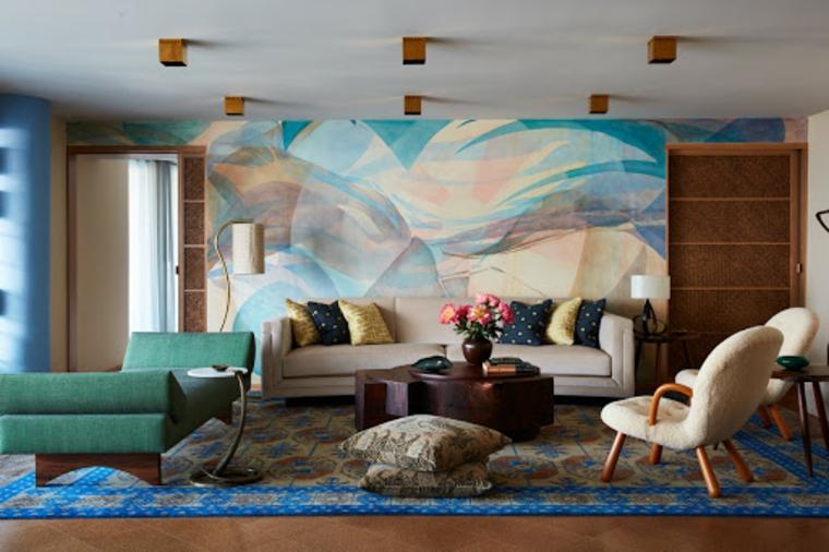 arredare bilocale divano soggiorno poltrona tappeto faretii soffitto tavolino