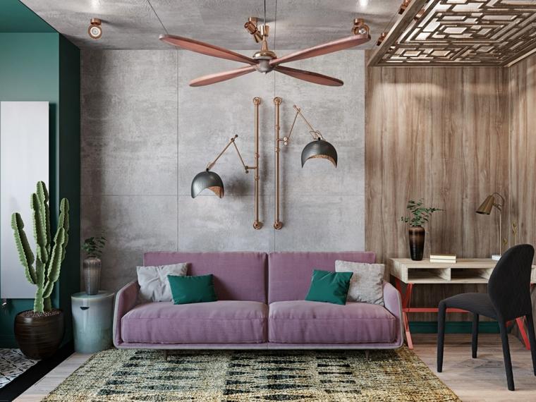 arredare mini appartamento divano viola soggiorno scrivania decorazione vasi cactus tappeto lampadario