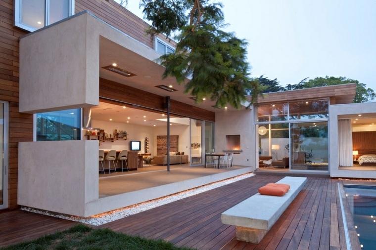 casa moderna con piscina giardino con pavimentazione in legno