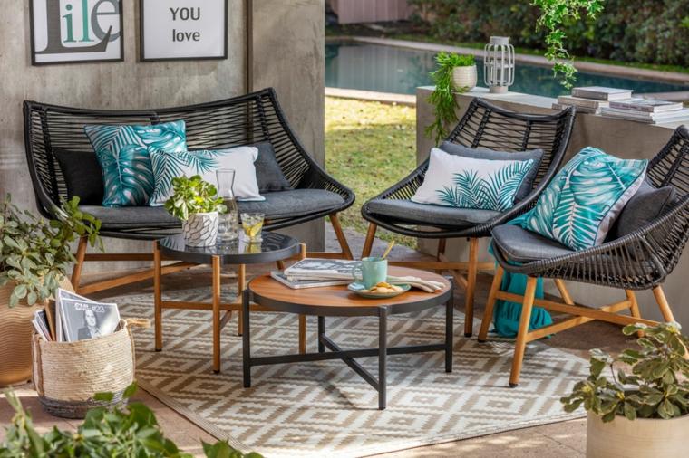 giardini moderni arredamento con mobili in plastica a rete tavolino rotondo abbinato