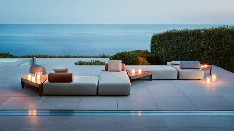 giardini moderni minimal arredo con divano da esterno decorazione con candele