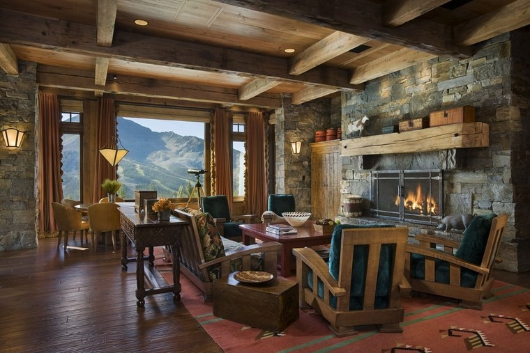 arredamento-rustico-camino-pietra-soggiorno-mobili-legno-vista-montagna-decorazioni-parete