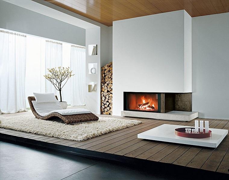 camini-rustici-legno-sdraio-interno-vimini-cuscineria-bianca-pavimento-rialzato