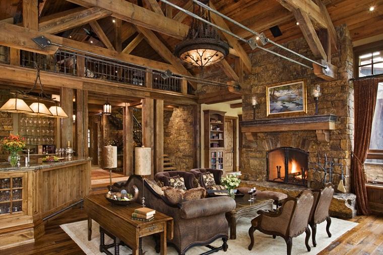 camino-in-pietra-set-mobili-pelle-tavolo-legno-lampadario-soffitto-travi-vista