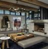 camino-rustico-molto-grande-divano-grigio-lampadario-sospensione-travi-soffitto