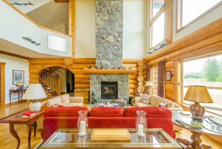 camino-rustico-pietra-legno-divano-rosso-pavimento-chiaro-casa-due-piani