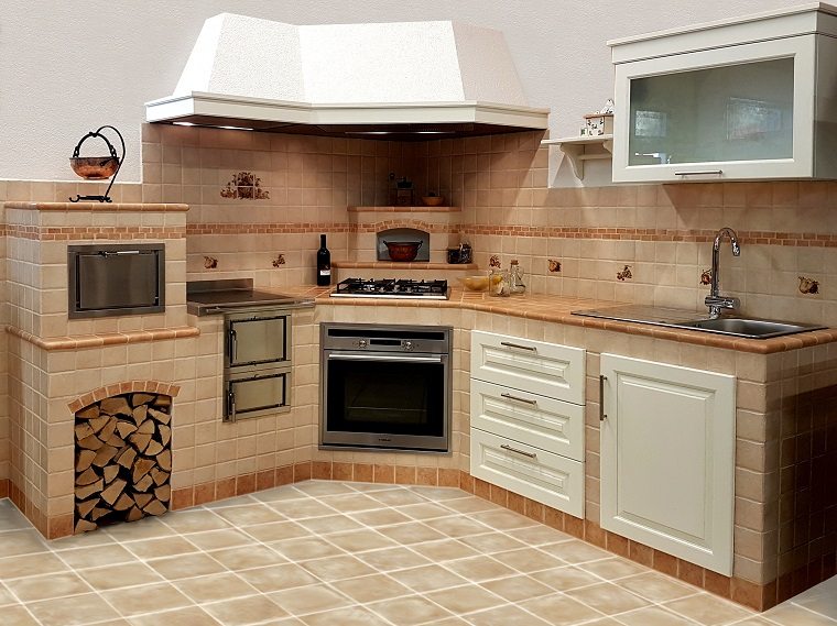 Cucina in muratura solidit tradizione e atmosfere for Forno a legna in mattoni refrattari