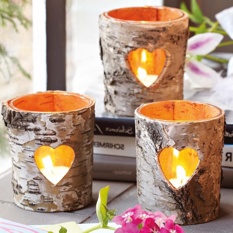 idee-regali-natale-romantica-luminosa-candele-forma-cilindro-legno-cuore-intarsiato-davanti