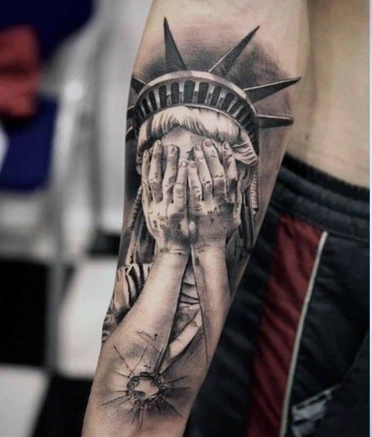 tatuaggi-avambraccio-statua-liberta-mani-volto
